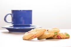 Three fresh cookies with coffee mug Royalty Free Stock Image