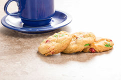Three fresh cookies with coffee mug Royalty Free Stock Images