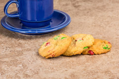 Three fresh cookies with coffee mug Stock Images