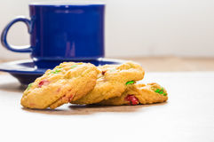 Three fresh cookies with coffee mug Royalty Free Stock Photos