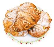 Three fresh croissants on plate Stock Photography