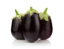 Three Fresh Eggplant on white Stock Photo