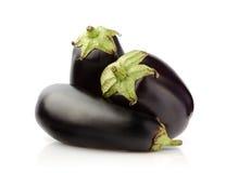 Three Fresh Eggplant on white Royalty Free Stock Images