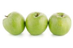 Three fresh green apples Stock Photography
