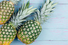 Three fresh green tropical pineapples Royalty Free Stock Images