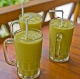Three fresh mango milkshakes Stock Images