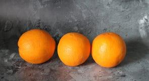 Three fresh orange Stock Photos