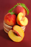 Three fresh peaches Royalty Free Stock Photography