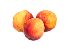 Three fresh peaches Royalty Free Stock Images