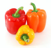 Three fresh peppers. Isolated on white Stock Photos