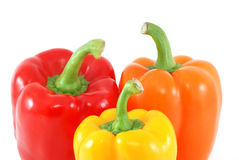 Three fresh peppers. Isolated on white Royalty Free Stock Photo