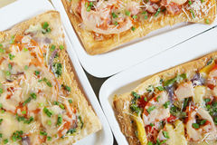Three fresh pizzas on plate Royalty Free Stock Image