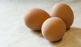 Chicken eggs on a marble surface stock images