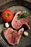 Three fresh raw pork chops Royalty Free Stock Image