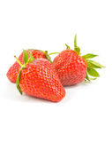 Three fresh red strawberries. On white background Royalty Free Stock Image