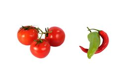 Three fresh red tomato and chili pepper Stock Images