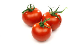 Three fresh red tomatoes Stock Photography