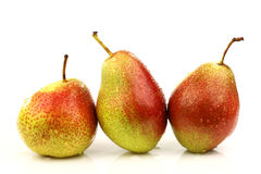 Three fresh red and yellow pears Stock Photo