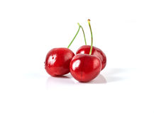 Three fresh ripe cherries. On white background Stock Photography