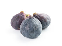Three fresh ripe figs isolated on white Royalty Free Stock Images