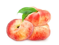 Three fresh ripe peaches with leaf. Stock Photo