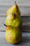 Three fresh ripe pears in row Stock Photography