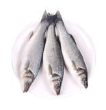Three fresh seabass fish on plate. Royalty Free Stock Image