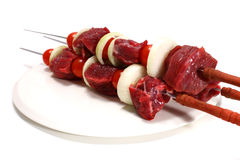 Three fresh shish kebab. On white dish Royalty Free Stock Photography