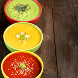 Three fresh soups on a wooden table Royalty Free Stock Photos