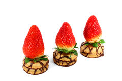 Three fresh strawberries on a cakes Royalty Free Stock Image