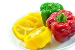 Three fresh sweet pepper on ceramic bowl Stock Image