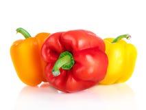 Three fresh sweet pepper on white background