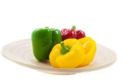 Three fresh sweet pepper on wood bowl Stock Photo