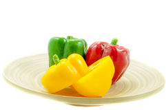 Three fresh sweet pepper on wood bowl Stock Photography