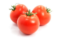 Three fresh tomatoes on white background Royalty Free Stock Images