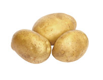 Three fresh and washed potatoes Stock Photo