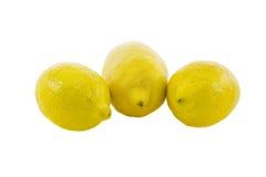 Three fresh yellow lemon. Isolated over white background Stock Images