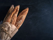 Three freshly baked baguettes on the table. Royalty Free Stock Photography