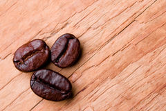 Three fried coffee beans Stock Images