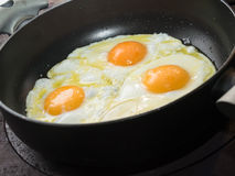 Three fried eggs Stock Photos