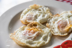 Three fried eggs whites for breakfast stock images