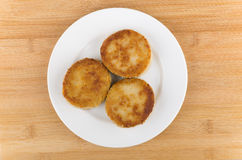 Three fried meatballs in white plate glass on wooden table Stock Photos