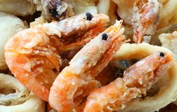 Three fried shrimp in the takeaway restaurant stock images