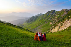 Three friend looking upon a map and landscapes. royalty free stock photo