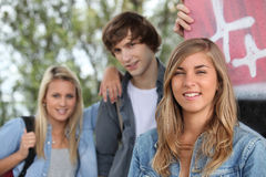 Three friend stood togheter. Three trendy young friends stood together Royalty Free Stock Images