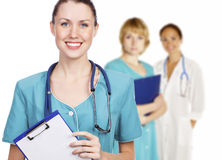 Three friendly healthcare workers. Hospital team. Three friendly healthcare workers on white background Stock Image