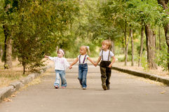 Three friends. Three young friends go for a walk the park Stock Photos