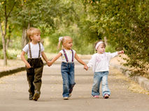 Three friends. Three young friends go for a walk the park Royalty Free Stock Image