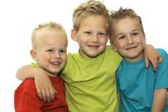 Three Friends. Holding each other, loving and hugging stock image