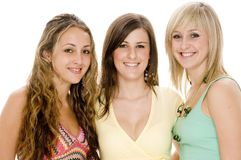 Three Friends. Three attractive young women in colorful casual clothing Royalty Free Stock Images